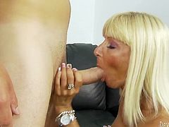 Eye catching mommy with big silicon boobs in black nylons rides her boy in reverse way. After getting banged in standing pose busty hoe sucks that fat cock and swallows the load.
