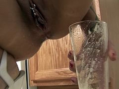 Her smooth pussy looks dashing while being stretched so fine and wetted with juice in such kinky solo scene