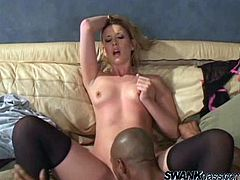 A gorgeous blonde slut sucks on this dude's big black cock and fuckin' takes it in her fuckin' gash, hit play and check it out right here!