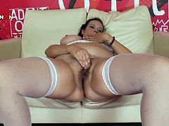 Insatiable black haired hottie in white stockings sat on sofa with her legs spread apart and enjoyed fingering her kitty tough. She held huge dildo in the other hand and sucked it ardently. Have a look at that hungry whore in Porn XN sex video!