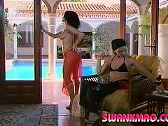 Sexy lesbians fuck in a courtyard. A blonde girl licks brunette's tits and a pussy for cash. Then they also toy each others pussies with a double dong.