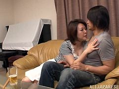 A lustful Asian cougar shows her passion and love for sex. A younger guy massages her boobs and fucks in shaved pussy. She feels so good that can't stop moaning.