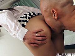 A sexy Japanese girl lifts a skirt up to show her ass. A bald guy licks Shiho's bald pussy and gets his dick sucked. After that the girl gets fucked from behind.