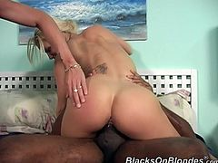 Click to watch this blonde babe, with big jugs wearing high heels, while she goes hardcore with a black dude and moans like a dirty lady!