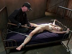 Looks like miss Cherie has been a bad girl and now she's receiving what she deserves! The executor starts out by pouring hot wax on her belly and then he dildo fucks her juicy pink pussy. Cherie is tied hard with rope and the knots won't loosen up just like her executor won't go easy on her ass!