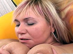 Chunky light haired MILF jiggles her saggy hooters while getting her shaved meaty cunt boned by massive black dick in doggy and missionary positions.
