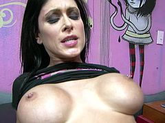 Seductive and well shaped brunette Jessica Jaymes passionately rides her boyfrirnd's big cock in reverse cowgirl position.