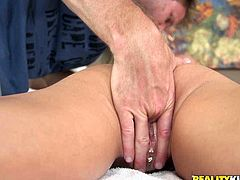 Horny dude oils up slender blonde and spreads her buttocks to rim her anal hole. He spreads her legs wide open and finger fucks and licks her smooth pussy.