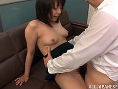Click to watch this Asian brunette, with natural boobs wearing her job uniform, while she gets fucked in a wild threesome and moans loudly.