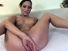 Lusty brunette whore Amber Rayne fucks her anus with big baseball beat