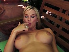 Blake Rose with big breasts and shaved cunt does striptease before she masturbates with desire
