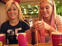Alison Angel and her female friend talk on camera in some cafe. Alison also pulls down a t-shirt to show her juicy boobs.