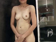 Feeling her nude forms while bathing got this hot angel a bit horny and in need for some stimulation