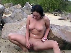 Brunette girl looks quite amazing while stroking wet cherry in dashing outdoor masturbation spectacle