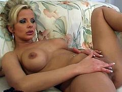 A gorgeous blonde MILF takes off her clothes and lies down on a sofa. This hot solo model opens her legs and masturbates.