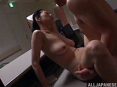 A Japanese MILF in a nurse uniform gets seduced by a patient. She takes off her panties and then gets fucked from behind.
