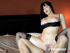 Touch yourself as you watch this brunette cougar, with big love pillows wearing sexy stockings, while she gets pounded hard and moans like a wild MILF.