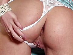 Aimee Addison does striptease before playing with her beaver