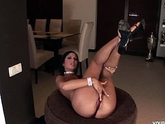 Brunette with firm titties Angelica seductively stripping her sexy lingerie and loves spreading her legs fondling her pussy. She is not contented as she used her glass dildo stroking it until she is soaking wet.