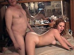 Curly-haired redhead Cherry Poppens is having fun with some dude in a bedroom. She shows her nice body to the guy and allows him drive his wang into her throbbing cunt.