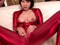 This girl never gets enough. To fulfill her insatiable desires, five men locked themselves together in a room. With the lights opened, the bitch wearing a red kinky costume matching with her high heels, slowly begins to undress. She shows off her boobs, shaved pussy and asshole. Observe how flexible she is!