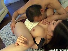 Horny Japanese slut Chihaya Yutsuk shows her massive natural tits to a man and lets him play with them. Then she sits down on his wang and they fuck in the reverse cowgirl position.