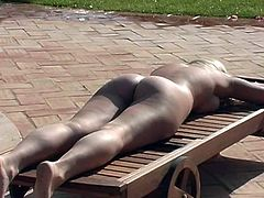 This time this slutty and horny bunny is getting naked outdoors by the poolside. She want some suntan and she is fine with some eyes around.