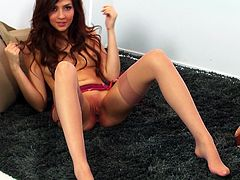 A glamorous bitch in a pink lingerie, stockings and high heels makes a hot solo show. She shows her perky tits and also rubs her hot pussy.
