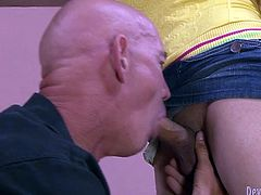 Sexy shemale lifts her skirt up and make one bald headed guy suck her cock. He sends her dick deep in her throat and licks her nuts with pleasure.