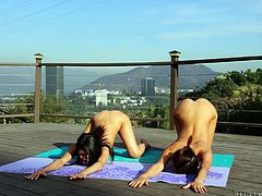 These sexy chicks are out on the balcony doing yoga when things get sexual. They spread their legs wide and show off each other's pussies. The sexy girls kiss and get each other so wet. Watch what they do next.