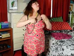 Chubby Rubee is wearing her sexy lingerie and black pantyhose. She flaunts her huge natural titties fondling her nipples and found her huge sex toy stroking her mature pussy.