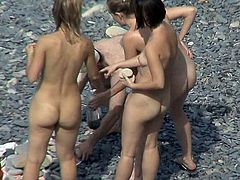 Naughty views through the hidden cam with nude beauties enjoying the beach while voyeur spies on them
