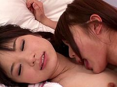 This cute Japanese teens are so naughty. The cute lesbians after having a slumber party, but soon things turn sexual. They lick each other's ears and touch each other in their private parts. They are so turned on just from kissing.