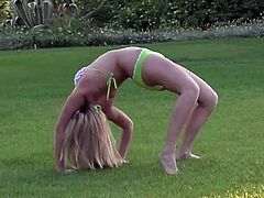 Some outdoor fun with a slutty blond siren Alison Angel! She is showing her acrobatic skills, being completely naked and that lawn.