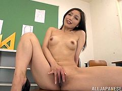 Damn, this Japanese chick is going to have a lot of fun, posing naked for her artist. He is painting her hot pussy and it is a must watch!