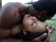 This pretty brunette sucks deep and gets nailed hard by a black dude by the pool in this steamy tube video.