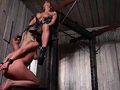 Sub girl in sexy bondage eats out mistress pussy