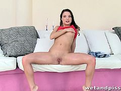 Nasty brunette girl Anita Berlusconi is playing dirty games in her room. She masturbates her shaved pussy with a dildo, then pees and drinks her juice.