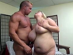 Obese tattooed blonde Kacey Parker lets a guy rub her fleshy snatch. Then she gives a blowjob to the man and they fuck in the side-by-side position.