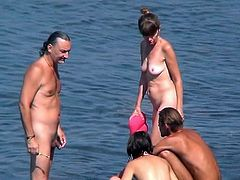 Seeing nude girls enjoying the beach makes voyeur to feel horny and in need for more spying