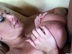 Horny blonde mom Alanah Rae shows her big fake boobs to some dude and makes out with him. Then they fuck in side-by-side position and doggy style and seem to be unable to stop.