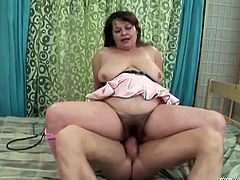 Brown-haired BBW called Jarka wearing stockings gives a blowjob to a guy and lets him play with her meaty and bushy twat. After that they fuck in the reverse cowgirl position.