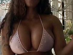 Captivating ebony girl shows her amazing natural tits to a guy. Then she kneels in front of him and drives him crazy with a deepthroat blowjob.