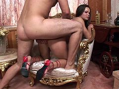 Have a blast watching this brunette babe, with a curvy body wearing red high heels, while she gets plowed hard on the floor after serving a blowjob.
