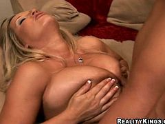Press play on this hot scene and take a look at Rachel Love's massive breasts as this sexy blonde oils them up before she's fucked silly.