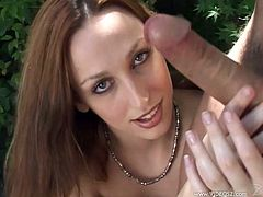 Get excited by watching this redhead babe, with a nice ass and natural breasts, while she uses her hands smartly behind the tress.
