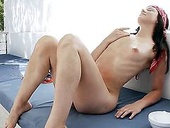 Leo with small tities and shaved twat does her best to turn you on in solo scene