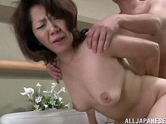 Check this brunette lady, with big breasts wearing a cute bra, while she gets drilled hard over a couch and moans like a slutty Asian female.