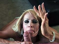 Vulgar blonde MILF with beautiful face Mikki Lynn works on massive cock with her bottomless throat. She sucks fat dick like a vacuum cleaner taking it up her throat balls deep.
