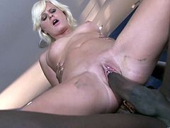 An this is a very interracial foursome sex scene. Sexy blond gets dicked by a black dude, while this ebony is riding a white cock!